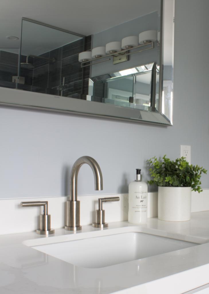 Bathroom sink and brushed nickel faucet