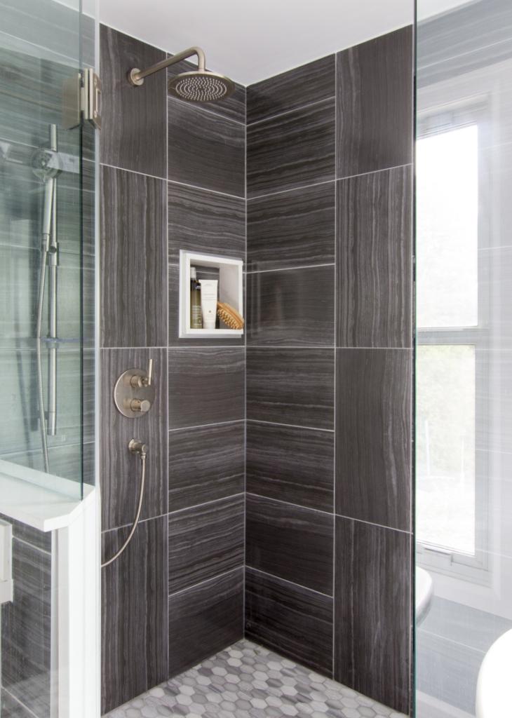 Master ensuite bathroom shower with dark tile
